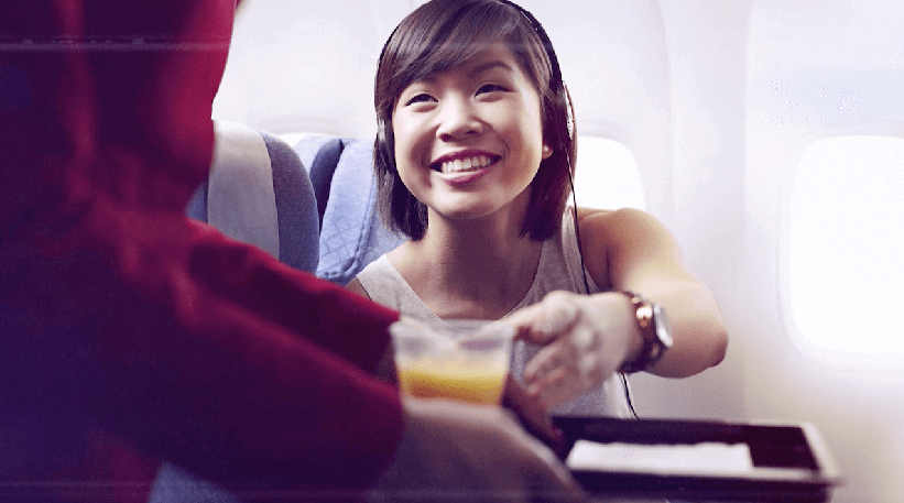 Girl Having Drink Screenshot- Cathay Pacific - JetSet TV