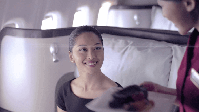 Girl Having Snacks Screenshot- Cathay Pacific - JetSet TV